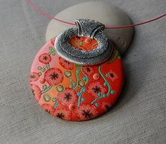 work is by Dumauvobleu on Flickr, aka Cathy: love the colors and the pierced decor