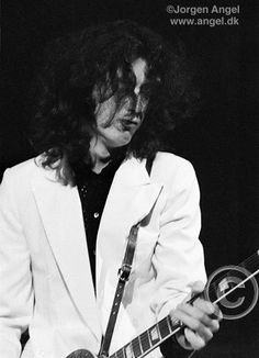 Jimmy Page...rare shot in this white suit jacket