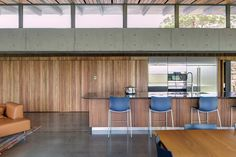 The warm tones of the custom island bench and kitchen wall in the public pavilion contribute to the sense of it being connected to its site.
