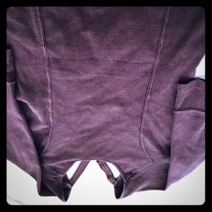 Rare Free People open back sunburst shirt Adorable Free People Washed plum form fitting shirt - darting on the front and back with an open sun pattern on the upper back. Very cute! Size L Free People Tops Tees - Long Sleeve