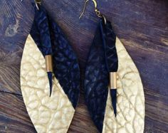 Black leather sculpted drop earrings with by thegivehandmade
