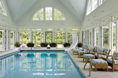 If only . . . crazy indoor pool:  huge Palladian windows; windows; transoms; + of course the slide