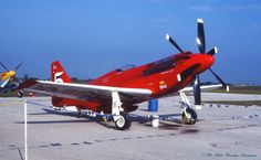 "the RED BARON!  Ed Browning's legendary Rolls-Royce V-12 Griffon-engined/contra-prop super-modified RB-51 Mixmaster Mustang- Race #5-""Red Baron"" (N7715C) on the ramp @ the 1979 Miami/Homestead International Air Races. The 2-time National Unlimited Class Gold Champion racer ('77-'78) held the title of- ""World's-Fastest Propellor-Driven Piston-Engined Aircraft"" 1979-1989."