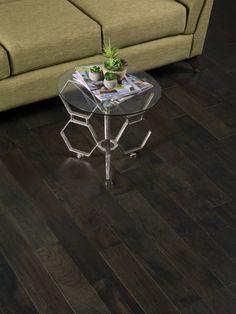 Tasmanian Night Acacia Hardwood Flooring with the most stunning hexagonal table. Wooden flooring can really show off beautiful furniture