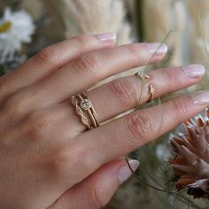 Full of texture, nature-inspired shapes and muted diamond hues, the Boho Stack was made for the artistic dreamer. A warm champagne diamond glistens in the nest of 14K matte yellow gold while glittering Round Brilliant Cut stones appear in pops of delicate pods. The Arrow Ring can be worn as a sweet midi-ring or adjusted for a more open fit at the base of the finger.