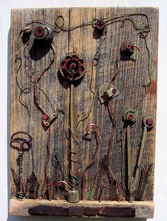 Art Assemblage found object flowers on antique by bearpawrustics. $115.00, via Etsy.