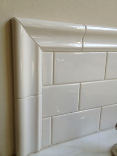 This Is My Tub Surround, Three Tiles High, But We Used A Thick Trim Piece.  I Have A Large Window On One Wall That Prevented Me From Tiling Any Higher.