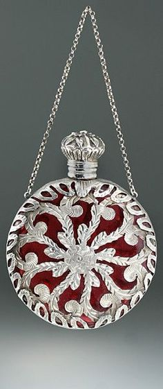 C. 1880 French cranberry glass scent bottle in ornate metalwork casing