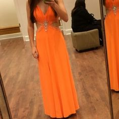 Brand new prom or homecoming dress Stunning orange formal dress. It's a size 4 petite however I usually wear around a 2 or 0. Brand new with tags. Group usa Dresses