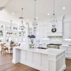 """Evin Blake Home on Instagram: """"Who doesn't love the clean look and feel of a classic white kitchen?! While this kitchen might seem sterile to some, it definitely offers a…"""""""