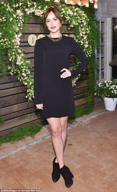 Black is best: Dakota Johnson played it safe in a long-sleeved LBD which unveiled her slen...