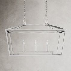 This 3-light pendant is thoughtfully crafted from sturdy metal with an openwork silhouette that adds a little something special to any kitchen or dining space. Inside, a trio of candle-style sockets holds bulbs up to 60W (not included). This hardwired design is rated for dry rooms and is also compatible with a dimmer switch so that you can adjust the light to your liking in no time at all. We love how this ambient light fixture looks when hanging above a butcher-block kitchen island or wooden di Home Office Cabinets, 3 Light Pendant, Ambient Light, Wooden Dining Tables, Kitchen Lighting, Bulbs, Light Fixtures, Kitchen Island, Candle