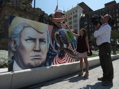 Elmira-based artist Julian Raven was displaying a reproduction of his 20 by 30 foot mural 'Unafraid and Unashamed,' featuring Donald Trump, on Tuesday afternoon in Cleveland's Public Square.