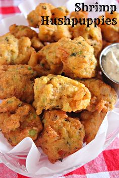 Shrimp Hushpuppies: • 1 c. yellow cornmeal • ¾ c. self rising flour • 1 tsp. salt • 1 tsp. cayenne pepper • ½ tsp. paprika • 2 tbsp. sugar • 1 tsp. onion powder • 1 small sweet Vidalia onion, minced • 3 stalks celery, minced • ¼ c. chives, minced • 7 oz. cooked deveined shrimp • 1 c. milk • 1 egg • Peanut or Canola oil for frying • salt and pepper to taste