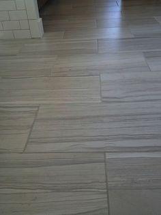 12x24 tile installed horizontal brick pattern. rain head