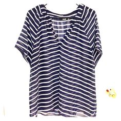 Sheer short sleeve navy blue and white blouse Super cute sheer navy blue and white striped blouse size XL. Loose fit. I wore it on Fourth of July with a red bubble necklace. a.n.a Tops Blouses