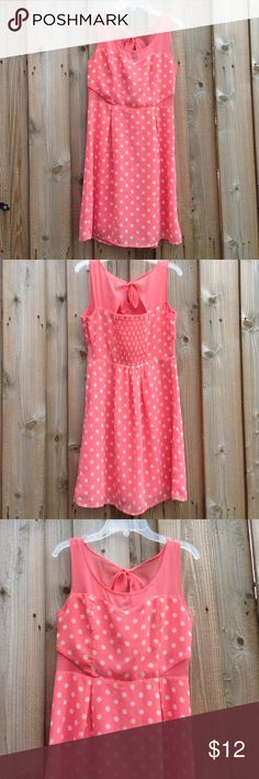 Pink Polka Dot Dress  Short sun dress with sheer top and sheer side cutouts. Slip underneath dress. Cute tie and texture in the back. Falls about halfway down the thigh. Some slight fraying and pulls. Zipper and clip on the side. Jessica Simpson Dresses Midi