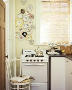 My dream apartment kitchen.  (Crazy, huh?)  Love the plates.  Must steal this idea.