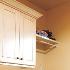 Cabinetry can hide detergent and cleaning supplies, as well as an ironing board, pull-out hampers, and sliding utility rails.