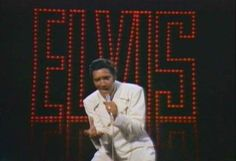 "Elvis Presley, Comeback Special 1968.    ""We're lost in a cloud  with too much rain.  We're trapped in a world  that's troubled with pain.  But as long as a man  has the strength to dream,  he can redeem his soul  and fly..."""