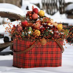 Winter may not be the time for a picnic, but don't store your picnic basket yet. This pretty plaid basket is filled with twigs secured in florist's foam and topped with frosted silk fruits and berries. This colorful arrangement works well inside and out.
