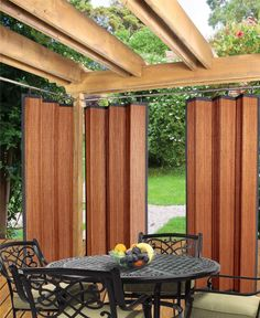Refresh your patio or poolside cabana with this bamboo curtain, showcasing contrasting trim and a ring top. Find something you love at jossandmain.com