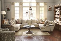I LOVE this sectional. It is huge, has English roll arms and white!
