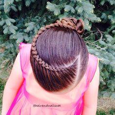 Lace Dutch braid into rope twisted bun