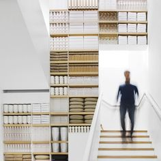 Shelves ceiling to floor, wall to wall, filled with multiples. Muji Shop, Italy by architect Roberto Murgia.