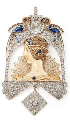 An important gold, ivory, plique-a-jour enamel, diamond and sapphire pendant attributed to Lluis Masriera, Barcelona, circa 1910.