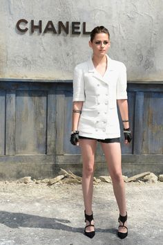 Kristen Stewart in a chic androgynous avatar at the Chanel Haute Couture Show. Love the structured blazer with a bun and with those shapely legs showing, we have no complaints.