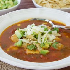 Add the fresh flavors of green chilies, cilantro and avocado to this warm Chicken Tortilla Soup.