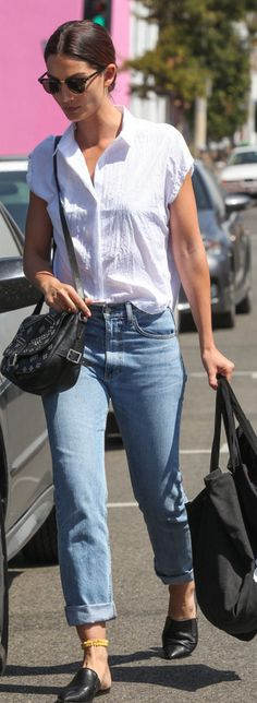 Who made Lily Aldridge's blue jeans, black print handbag, sunglasses, and mule shoes? Flat Mules Outfit, Mules Shoes, Mule Loafers, Flats, White Shirt Outfits, Cool Outfits, Travel Outfits, White Shirts, Fall Outfits 2018