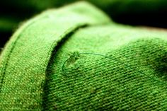 How to mend holes in woolens....Sew around the hole..great tutorial. I could have used this last week for the hub's favorite ratty sweater!