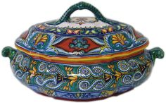 Franco Mari majolica from Deruta, Italy. Bought a few pieces while there. Addicted to his art and want bowls next!