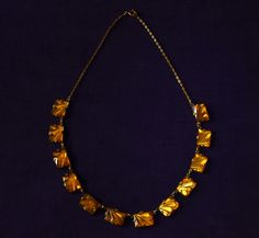 Foiled amber glass and gilt brass Art Deco necklace, 1920's.