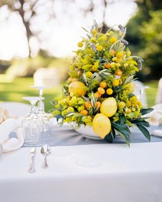 yellow & orange fruit wedding centerpieces    floral design by / http://annelangs.com