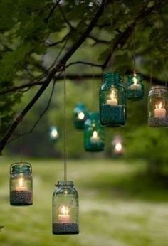 Mason Jar Lanterns. Great looking and cheap idea for an outdoor wedding, garden party or holiday barbecue