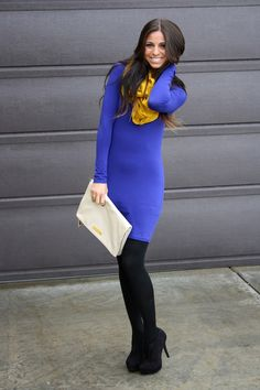 Royal long sleeve sweater dress, black opaque tights and pumps, great clutch, mustard infinity scarf...great pop!