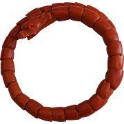 Carved Coral Serpent Bracelet