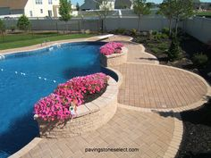 """http://deckandpationaturalstones.com/?p=3477 Golden brown pavers patio installed in east end long island built with Nicolock pavers on 1"""" of sand over recycled concrete base. Beige pavers inlay were installed for the borders and focal points. 6x9 pavers and 6x6 were used to pave outlined areas of the patio and the swimming pool patio. A paver art design was installed in front of the backyard stoop the house patio was connected with the swimming pool patio area with a walkway."""