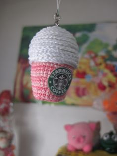 Starbucks Amigurumi. Photocopy the Starbucks logo onto a piece of fabric then cut it down to a circle and stitch onto your crocheted cup. Great gift for those Starbuck lovers.