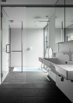 white + gray minimalist bathroom with walk-through shower // Mukawa House by Studio Aula