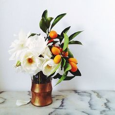 Add a full stem of fruit from the tree or even add a few branches to a centerpiece to give it some nature-inspired styling. Fresh from the garden!