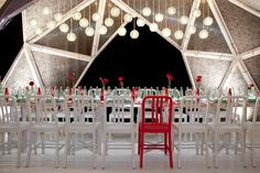 Pentagonal structures Stefan Beckman created a sleek, on-brand table for sponsor Coca-Cola using a variety of recycled items, including the overhead lights...