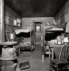 """March 1943. """"Iden, New Mexico. One of the bunk cars for section workers of a train on the Atchison, Topeka and Santa Fe Railroad between Clovis and Vaughn."""""""