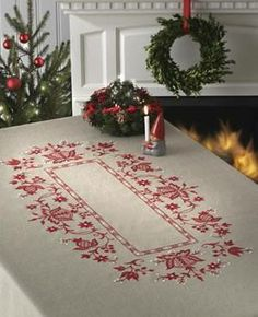 Create your very own Christmas tablecloth!... oh i really want this kit!!!! how special to know that i've made it!  its 65. quid.