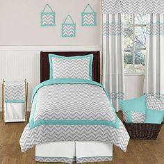 A twist on the traditional child's bedroom, this Sweet Jojo Designs Zig Zag Bedding Collection is decorated in grey and white chevron stripes with stunning turquoise accents. Step into style with one simple piece or the entire set for a whole new look.