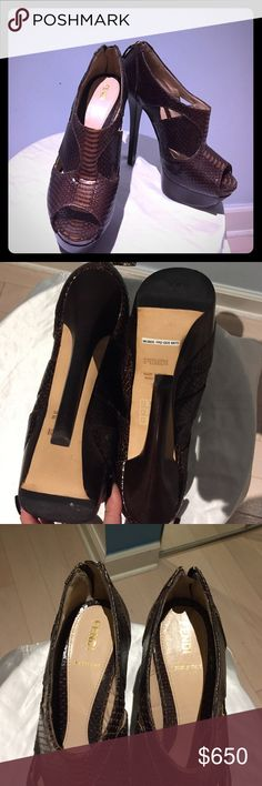 """Fendi snake skin peep toe booties Authentic Fendi platforms size 38 . Excellent condition, worn once for less then an hour , leather is clean , no scratches . Come with out box and original dust bag .  Measurements:  Heel 5.5"""" Platform 1.5""""  Insole 9.5"""" Fendi Shoes Ankle Boots & Booties"""