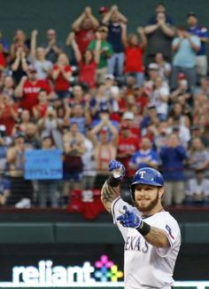 Texas Rangers left fielder Josh Hamilton (32) gestures to the dugout as the fans cheer after hitting a second inning double during the Boston Red Sox vs. the Texas Rangers major league baseball game at Globe Life Park in Arlington on Thursday, May 28, 2015. (Louis DeLuca/The Dallas Morning News)